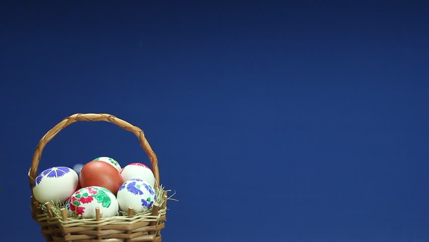 Wicker basket with easter eggs revolves and above it appears the easter basket with painted eggs which turns hd stock video clip negle Gallery