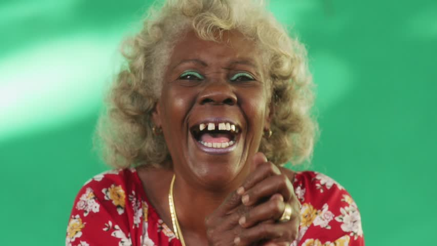 Old hispanic real people from Cuba with feelings and emotions, portrait of bizarre senior african american lady smiling, laughing and looking at camera. Elderly black woman with dental problems