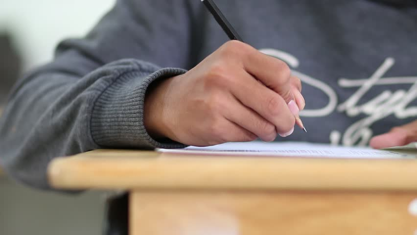 Close up boy hands of student writng during the test exam in classroom | Shutterstock HD Video #24520535