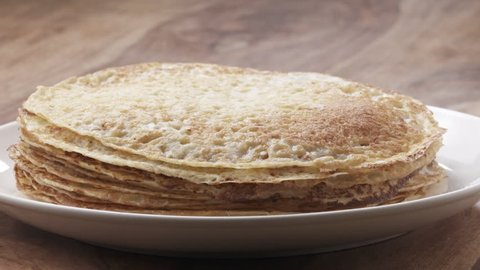 Slow motion of blin or crepe falling on stack, 180fps prores footage