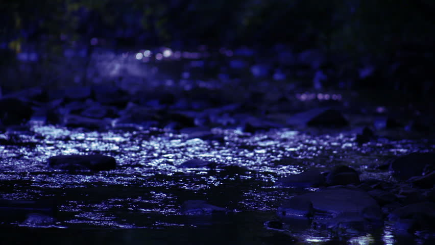 River flowing over rocks at night