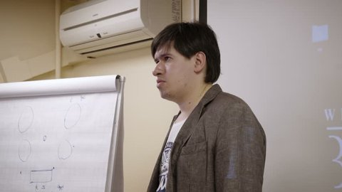 Man speaking on lecture in class