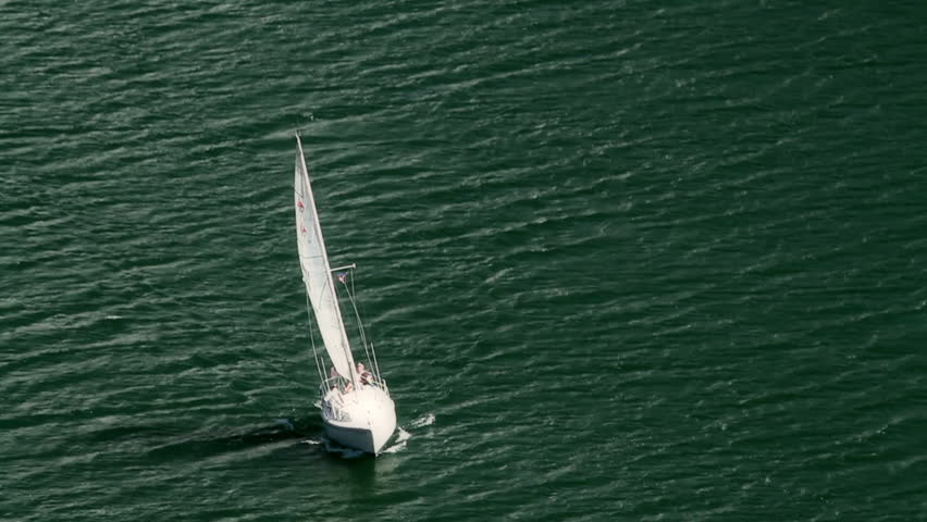 Sailboat sailing in the strong winds. Aerial view, HD 1080p.