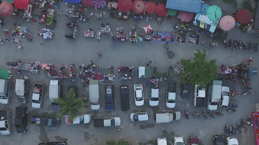 Thailand  Rural market,  aerial photography, red umbrella, people, life, | Shutterstock HD Video #24579875