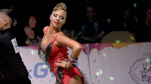 Poltava, Ukraine, Dec 2016 : Beautiful girl with artistic makeup dancing in the ballroom. Close-up, slow motion.