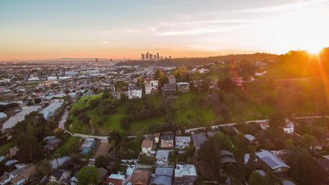 4K Aerolapse ( aerial timelapse / hyperlapse ) of the scenic city skyline view on Hollywood Hills and sunshine of the sunset in Los Angeles