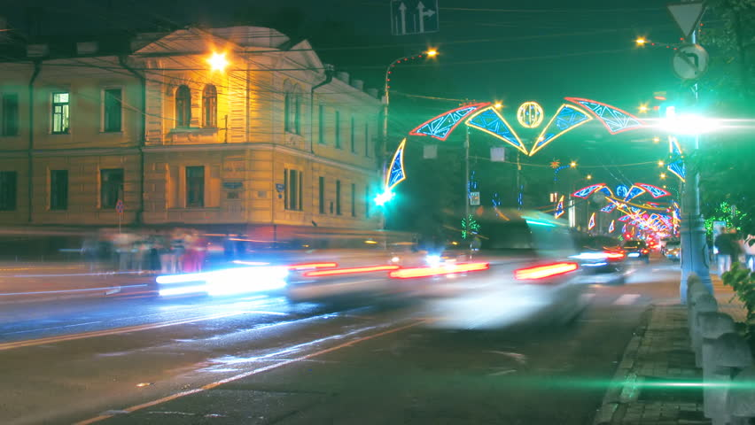 night city traffic on crossroad with festive illumination timelapse. Loopable, tags and logos are blurred, HD 1080p