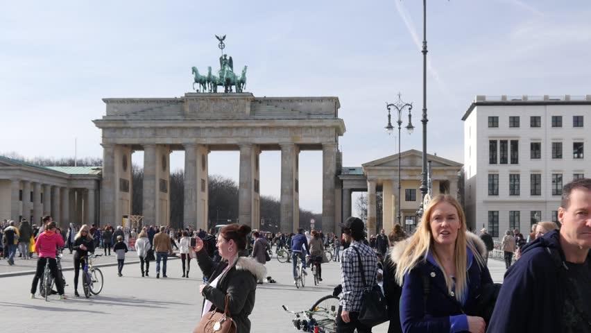 BERLIN, GERMANY - MAR 04, 2017: People Tourists Crowd Walk On Square Near Brandenburg Gate