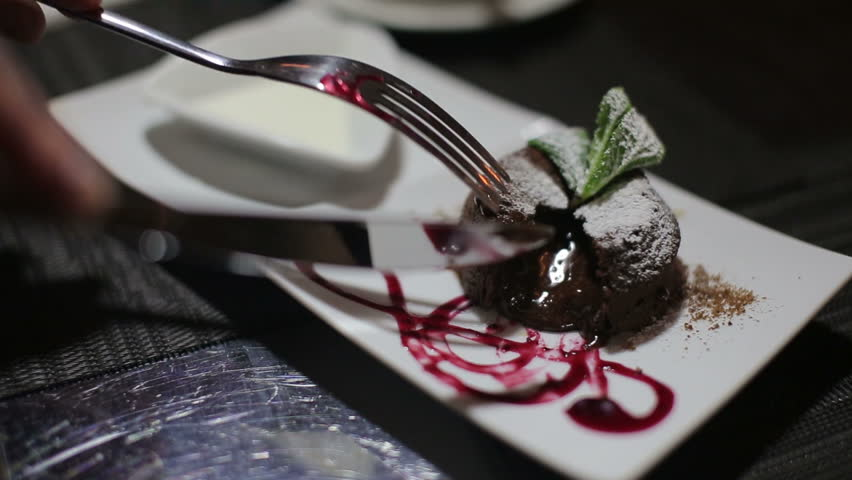 tasting brownie dessert with original feed from the chef in a luxurious restaurant