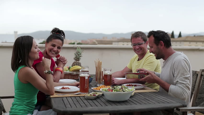 Group of friends celebrating dinner on the terrace