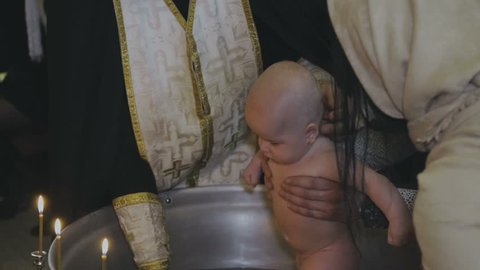The baptism of a child in the church