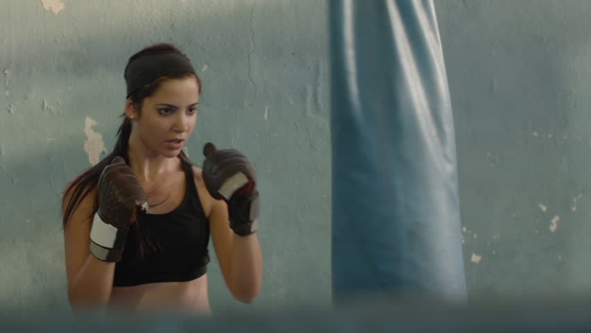Sport and people, woman, girl, beautiful young female athlete exercising for self-defense in boxing gym. Dolly shot | Shutterstock HD Video #2482574