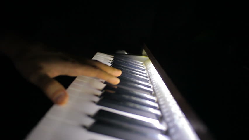 Game on the piano. Improvisation, own compositions in the dark.  | Shutterstock HD Video #24839579