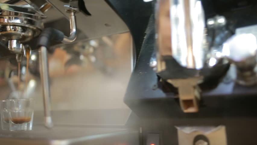 Barista prepares coffee in a cafe-bar, coffee grains