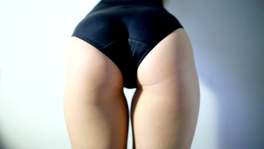 Attractive girl dancing twerk in the studio in black shorts on a white background video