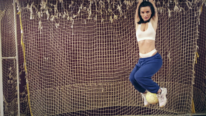 Sexy woman standing in football goal