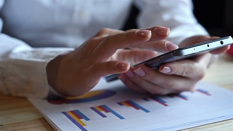 Woman Using Mobile Phone. Graph Money Stock Trading Up. Business Economic Concept