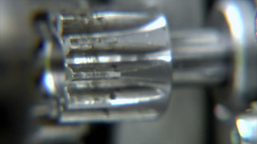 Close-up of rotating cogs with depth of field. Camera footage, NO CGI!