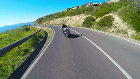 Motorcycle ride by the sea in Sardinia, Italy
