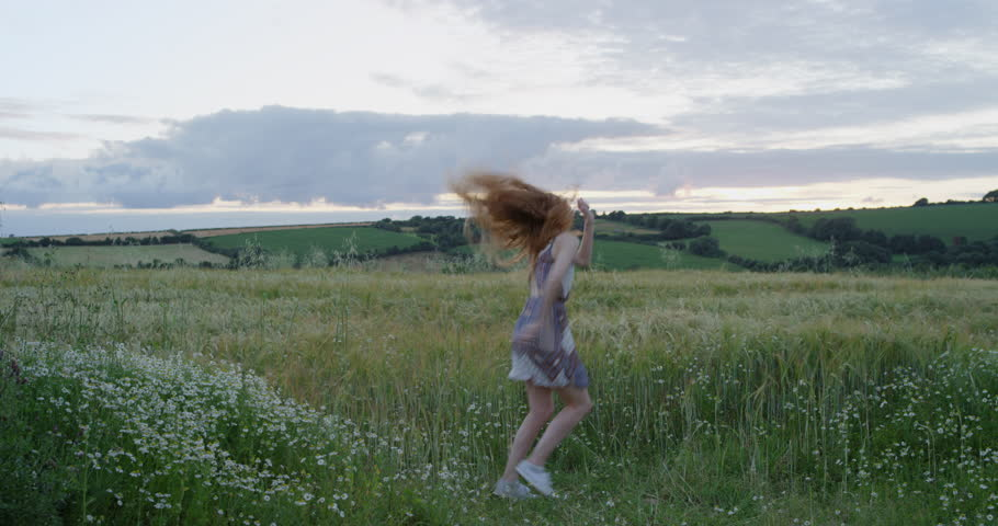 Girl approach on field with haystacks stock footage video 12093386 happy woman dancing silly freestyle dance in open green field 4k stock video clip ccuart Gallery