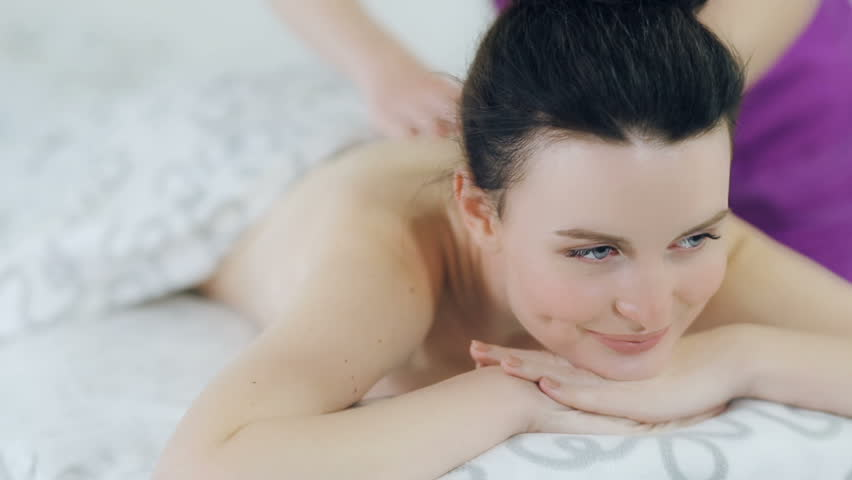 Masseur doing massage to woman