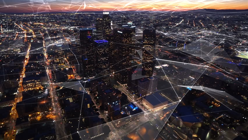 Connected aerial view of the Financial District in Downtown Los Angeles, California.  Sunset. Famous skyscrapers and freeway full of cars. Futuristic. Technology. Shot from helicopter. | Shutterstock HD Video #25021235