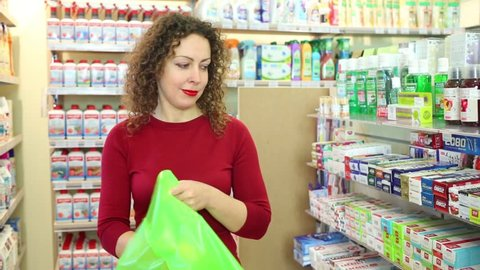 MOSCOW, RUSSIA - OCTOBER 14, 2016: Woman chooses and pouches a toothpaste into the package in the home goods store