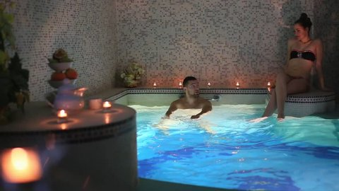 a couple on a date at beautiful swimming pool in sauna