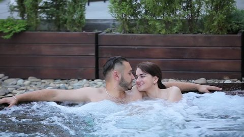 Couple resting in the jacuzzi.