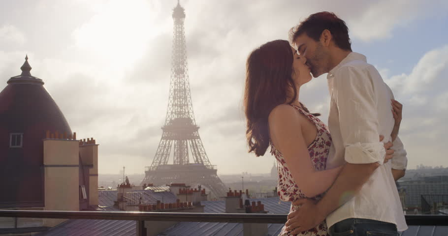 Romantic couple in Paris Eiffel Tower embrace kissing honeymoon enjoying European summer holiday travel vacation adventure | Shutterstock HD Video #25099157