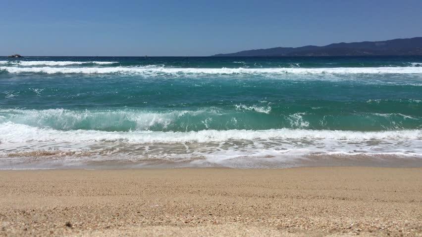Breaking of waves on a sandy beach
