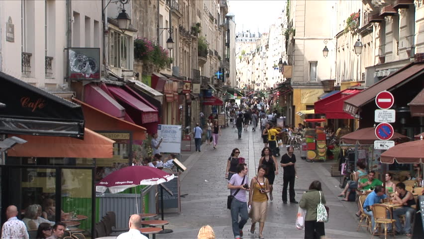 Paris, France - CIRCA June, 2006: A large crowd of people walk down a busy street during the day | Shutterstock HD Video #2511119