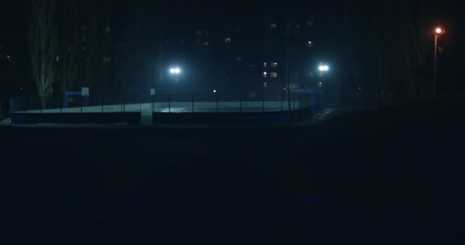 Scene: street sports at night. The stadium is lit by floodlights. Color contrast. Buildings on the background. Opening frame. Tilt and orange. | Shutterstock HD Video #25162475