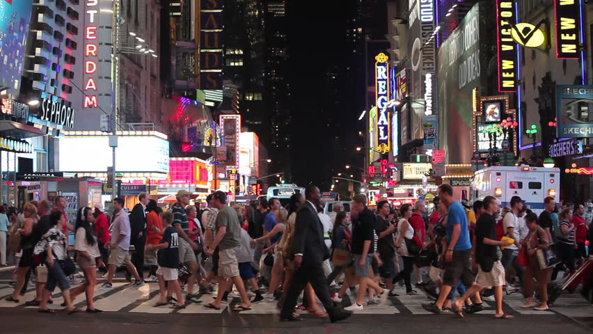 NEW YORK - CIRCA JULY 2012: Slow motion view of crowd of people crossing the street in Times Square at night circa July 2012 in New York, NY.