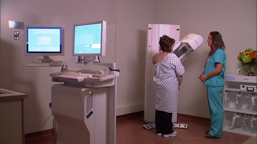 Woman receiving a mammogram in a clinic.