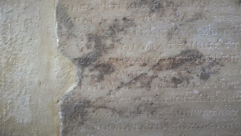 DELPHI, GREECE - AUGUST 2016 : One of the earliest example of notated music, the Delphic Hymns are two musical compositions addressed to Apollo. Stone fragments of early music notation.