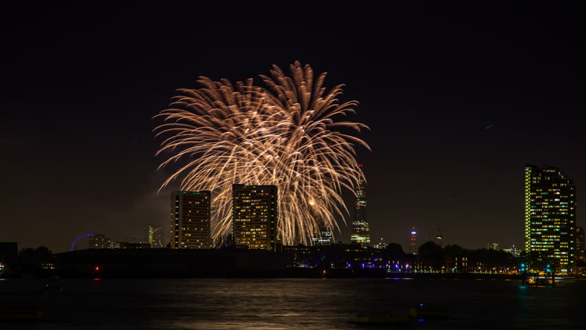 Night timelapse of fireworks over the Shard and river Thames, London, UK
