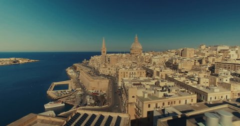 Aerial shot over Valletta moving towards St Paul's Cathedral
