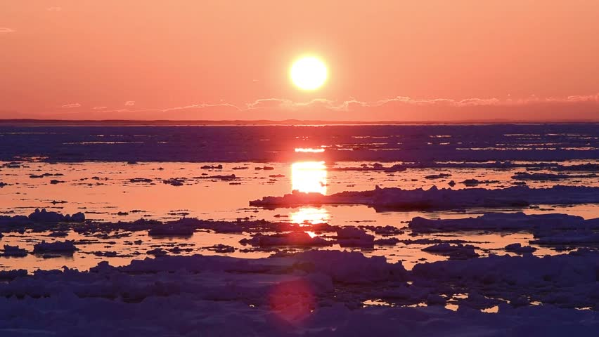 The Sea of Okhotsk of the setting sun and the drift ice