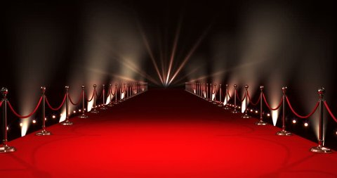 Digitally generated video of red carpet with spotlights against black background
