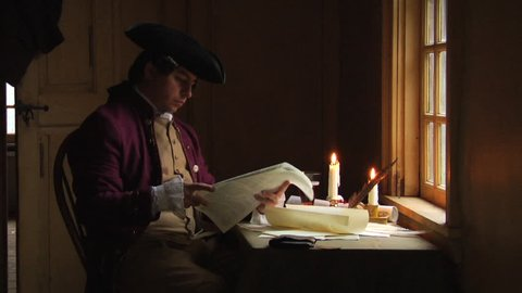 BOSTON - APRIL 1775 -- Reenactor, Re-enactment of Colonial American Patriots, Sons of Liberty, Continental Congress, writing at table before the American Revolution. Declaration of Independence.