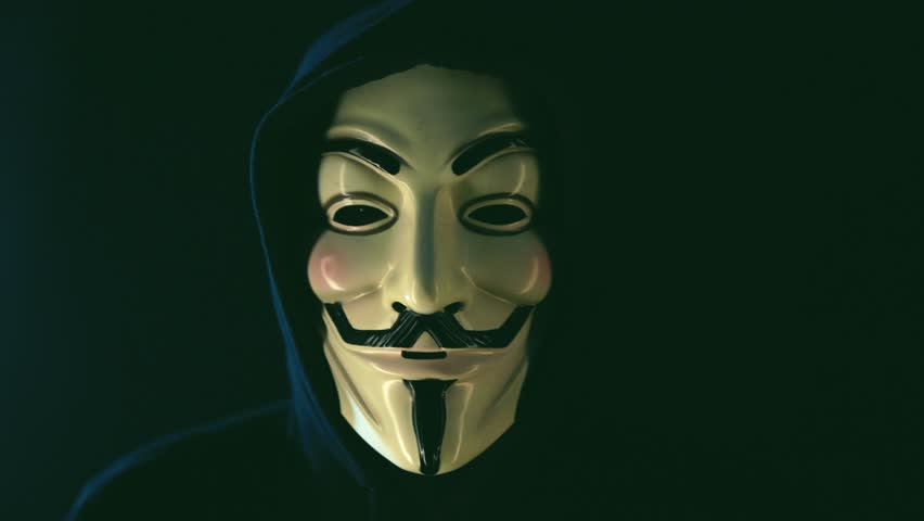 Aachen, Germany - March 01, 2017: Studio shot of Anonymous computer hacker wearing Guy Fawkes vendetta mask on March 01, 2017.