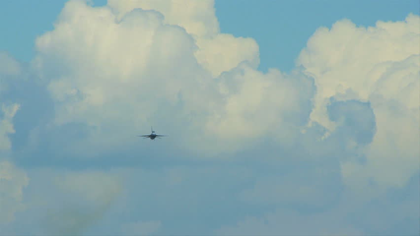 QUONSET, RHODE ISLAND - JUNE 2012: Air force F-16 Falcon flying towards camera and then going up at the Rhode Island National Guard Open House and Air Show in June 2012.