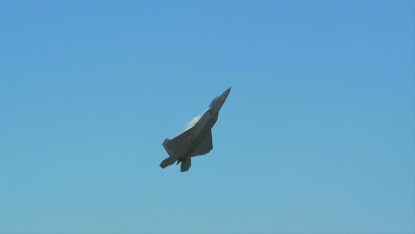QUONSET, RHODE ISLAND - JUNE 2012: Air force F-22 Raptor flying straight up at the Rhode Island National Guard Open House and Air Show in June 2012.