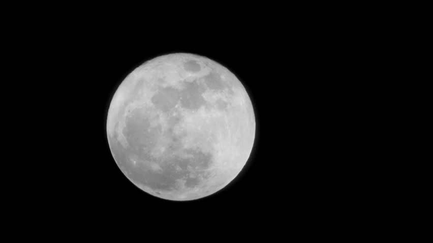 Full moon time-lapse as it eventually becomes obscured by clouds