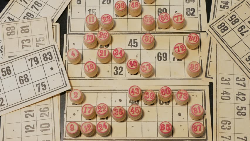 A man plays Russian Lotto. Hands closeup.