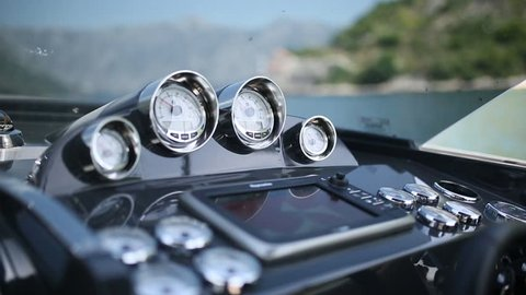Booster boats and dashboard. A modern boat. Expensive yacht. The captain controls the yacht.