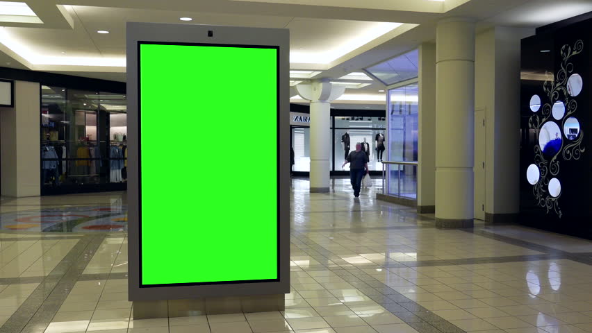 Burnaby, BC, Canada - March 07, 2017 : Motion of people shopping and green sreen billboard in the middle inside Burnaby shopping mall with 4k resolution