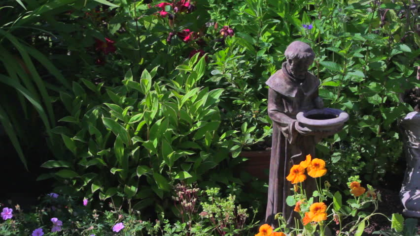 Pan Over Garden Flowers And St Francis Statue   HD Stock Video Clip