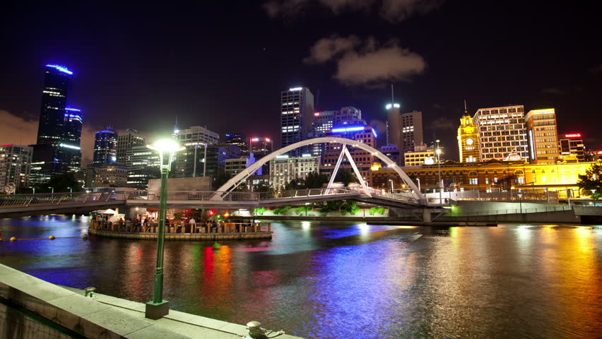 View over a pedestrian bridge in Southbank and skyline. timelapse effect at night, 18 January 2012 in Melbourne, Australia